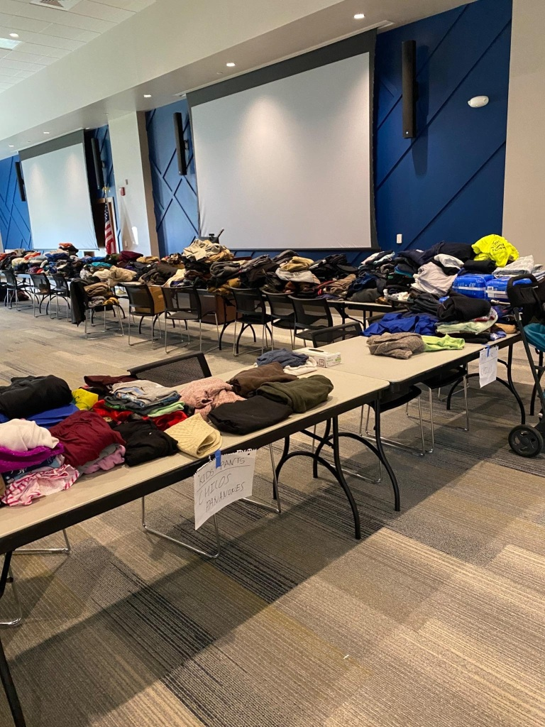 Tables covered with clothes donated at the Student Day of Service-Learning. Photo courtesy of Kirsten Collins.